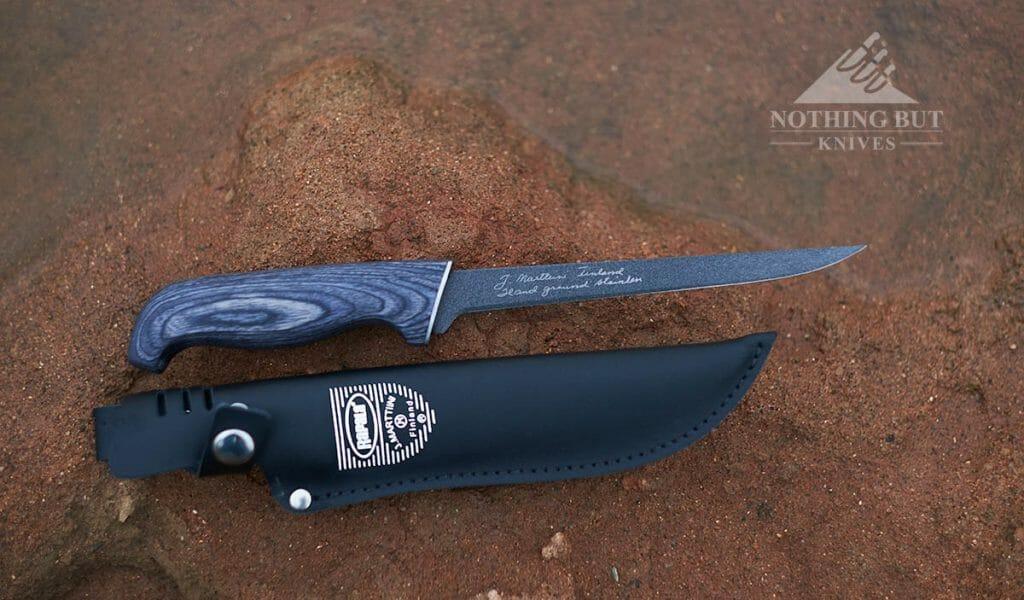 Rapala presentation fillet knife at the edge of a lake.